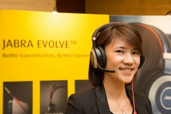 Gladys Kong Sales Manager Malaysia & Brunei posing with the top-of-the-line Jabra Evolve 80